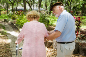 """Older gentleman helping his wife -- """"MMMNA"""" is one way to help our spouse have the income needed even while qualifying for Medicaid"""